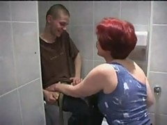 Granny fucks a younger man in the toilet