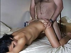 Busty tanned burnette with shaved pussy taking it doggy styl...
