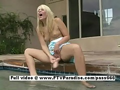 Blonde toying by the pool