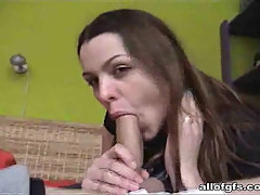Feeding brunette girlfriend with stick