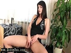 Brunette Rubs Her Pussy And Spreads Her Lips To Take A Pee