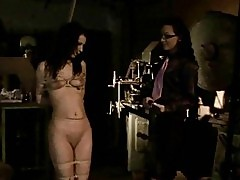 Young mistress playing with slavegirl