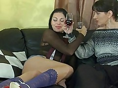 Two dark haired lezzies in stockings fingering and licking