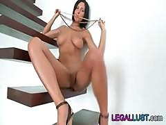 Brunette Babe Adria Posing And Rubbing Her Pussy With Pearls