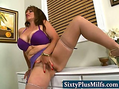 Hot sixty year young MILF teasing her fuck partner