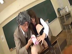Japanese girl blowing dicks in classroom