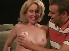 Mature Blonde Eats Younger Cock And Then Rides On It On Couch